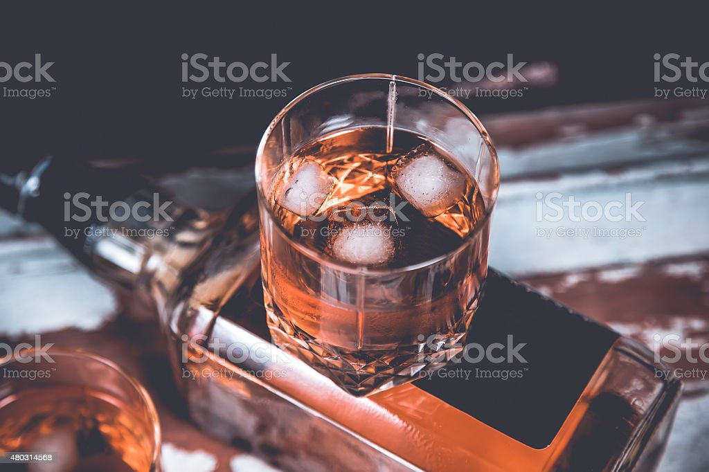 Two glasses of whiskey standing on the bar stock photo