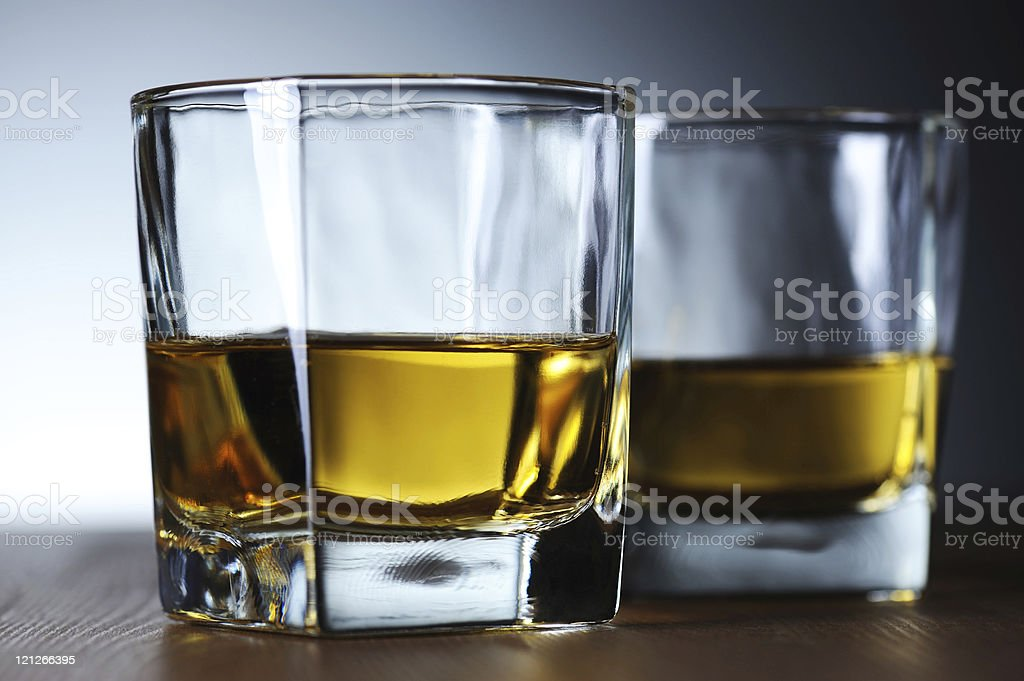 Two Glasses of Whisky Grey Background stock photo