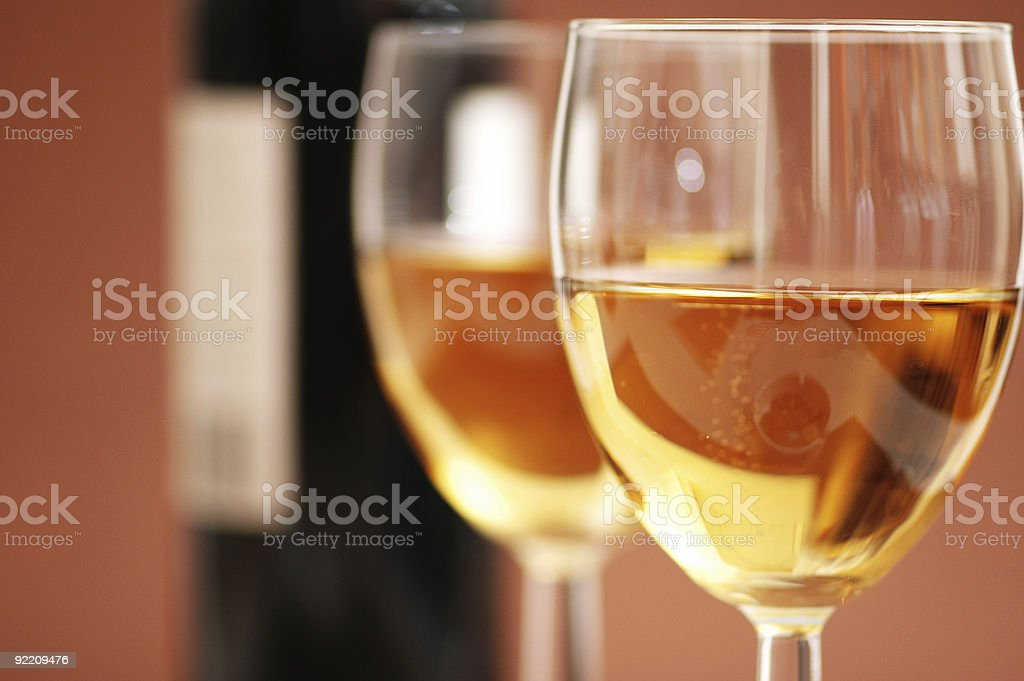 Two glasses of white wine and bottle royalty-free stock photo