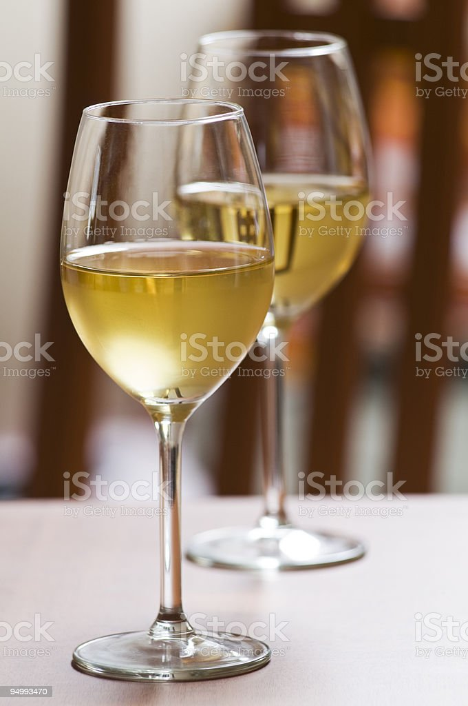 Two glasses of white wine on a table royalty-free stock photo