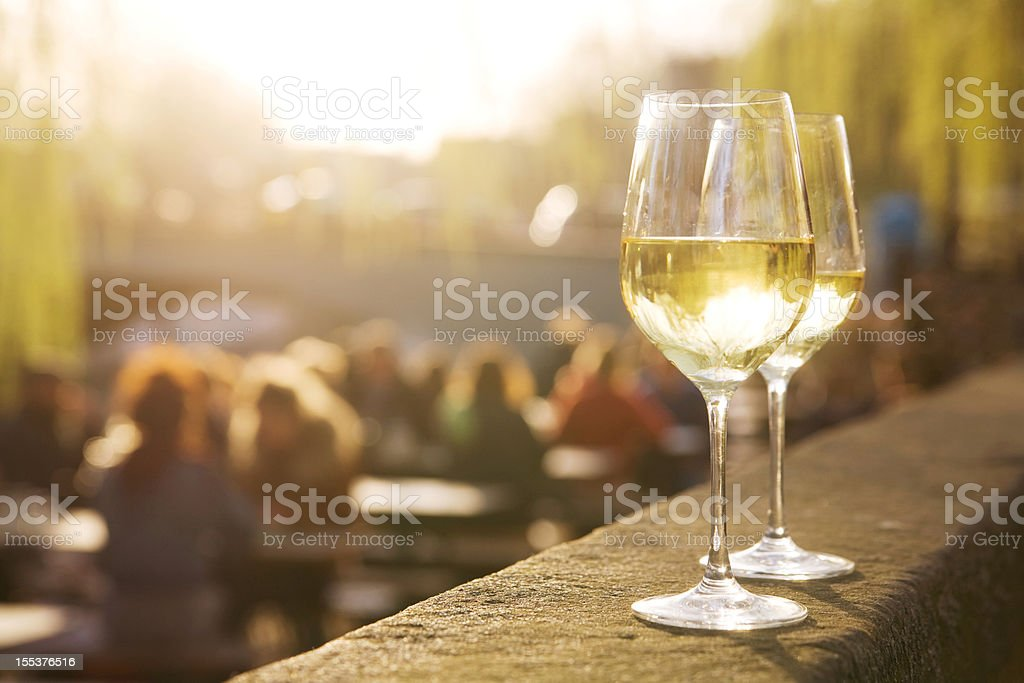 Two glasses of white wine on sunset stock photo