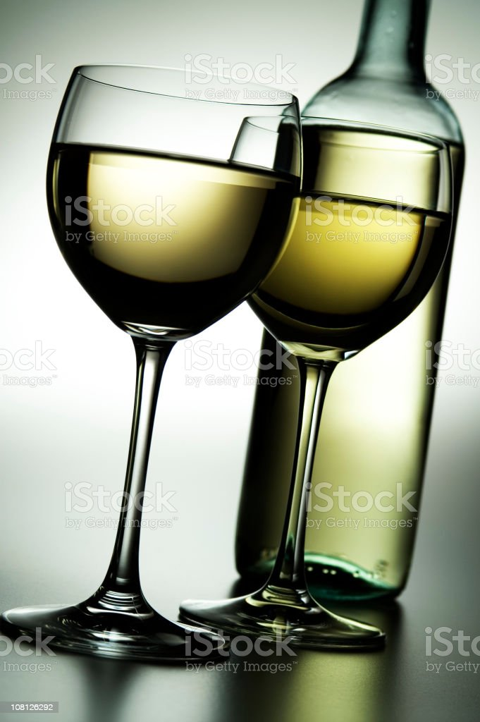 Two Glasses of White Wine with Bottle royalty-free stock photo