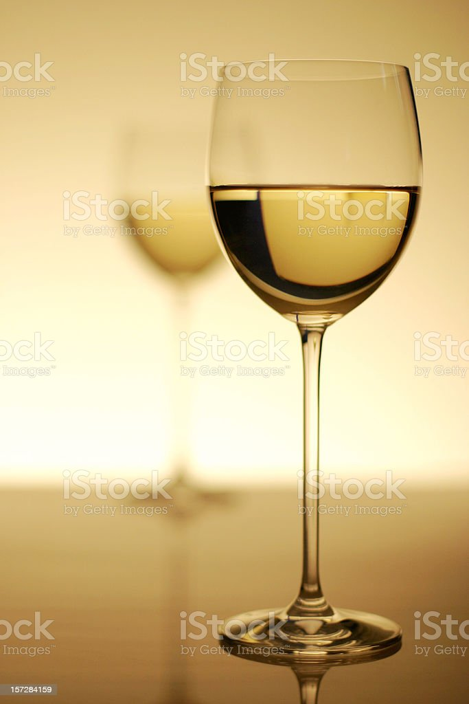 Two Glasses of White Wine with Dramatic Lighting royalty-free stock photo