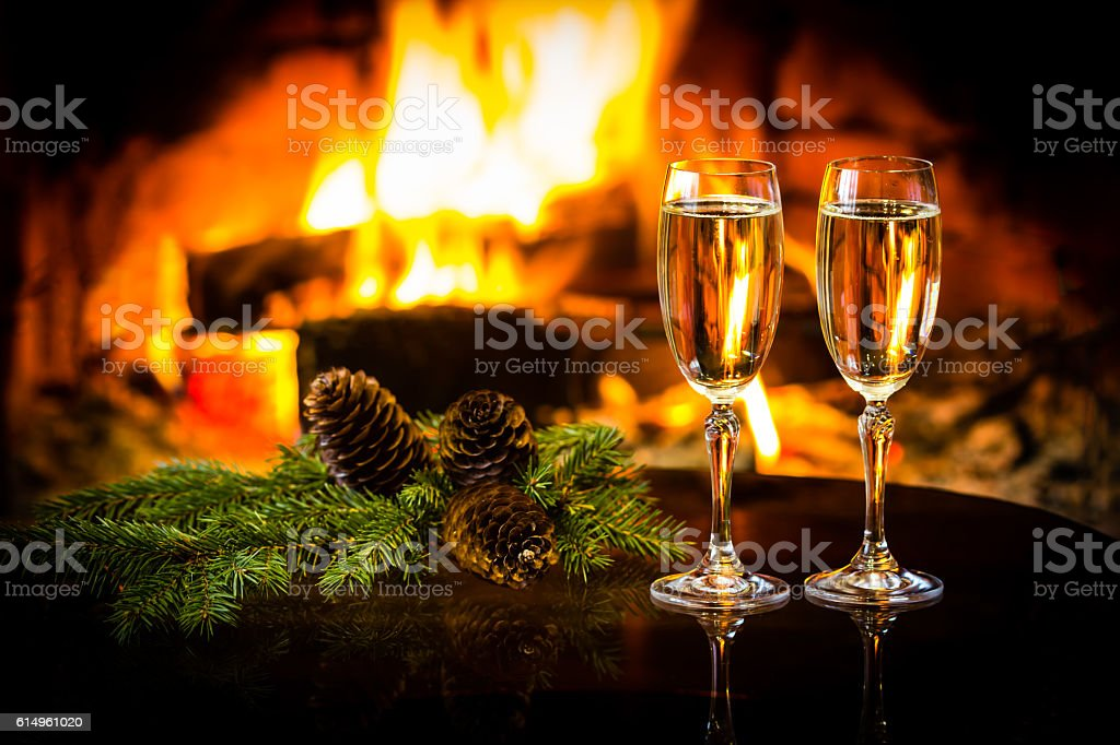 Two glasses of wine and Christmas New Year decoration, fireplace stock photo