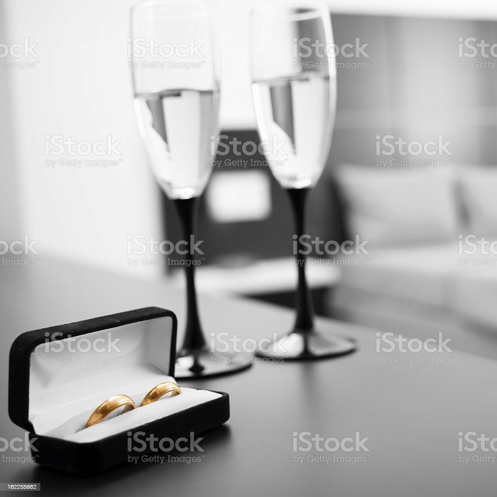 Two glasses of  wine and wedding rings royalty-free stock photo