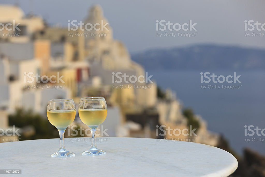 Two glasses of wine at sunset in Santorini, Greece stock photo