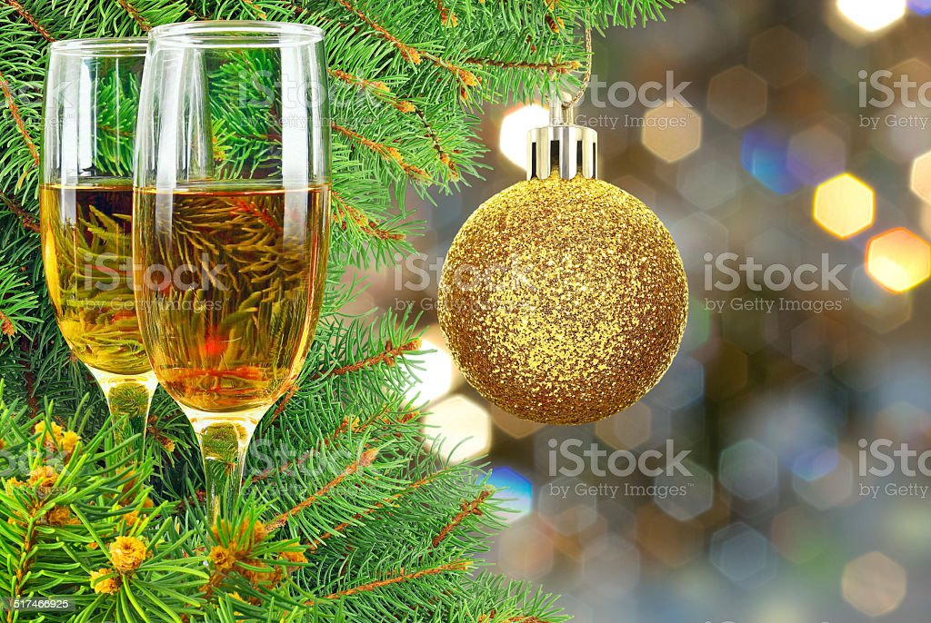 Two glasses of wine under the Christmas tree stock photo