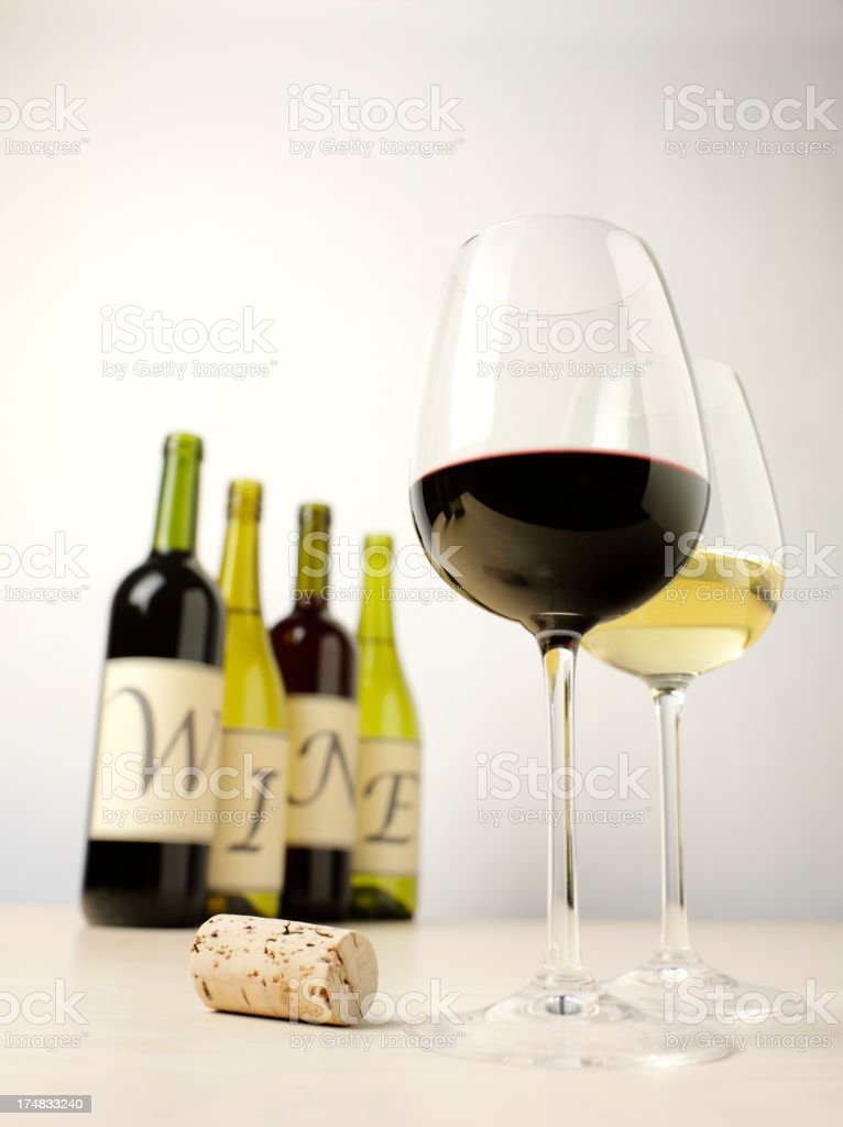 Two Glasses of Wine with a Word on Bottles royalty-free stock photo