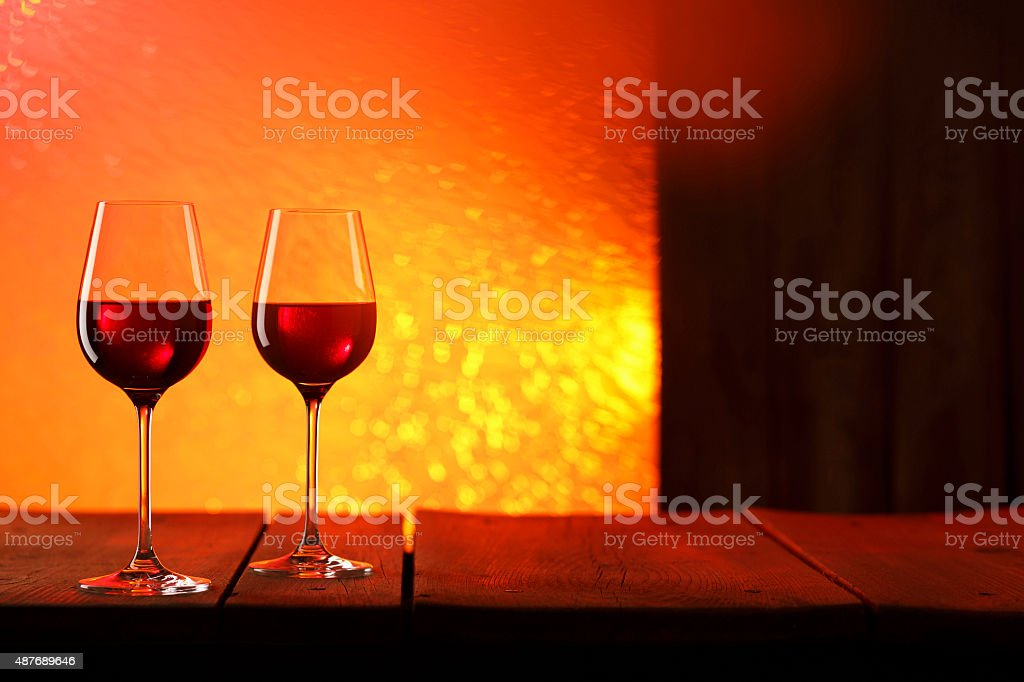 Two glasses   Red wine into stylish wineglass stock photo