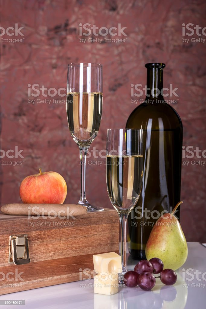 Two Glasses White Wine, French Cheese,Cigar,Red Grape royalty-free stock photo