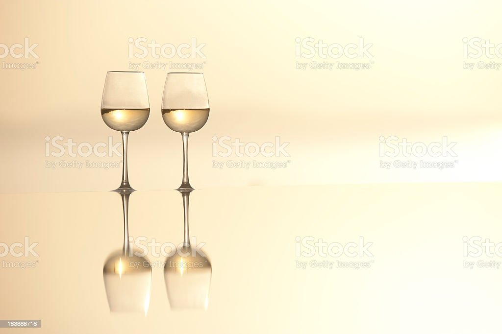 Two Glasses wine on the edge of a horizon pool stock photo