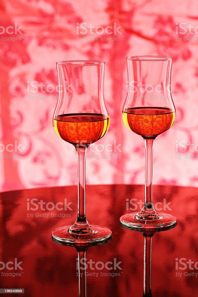 Two glasses with amaretto liqueur stock photo