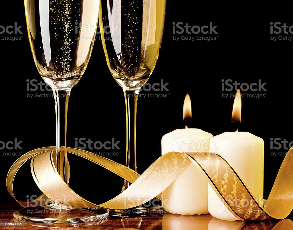Two glasses with champagne and candles royalty-free stock photo