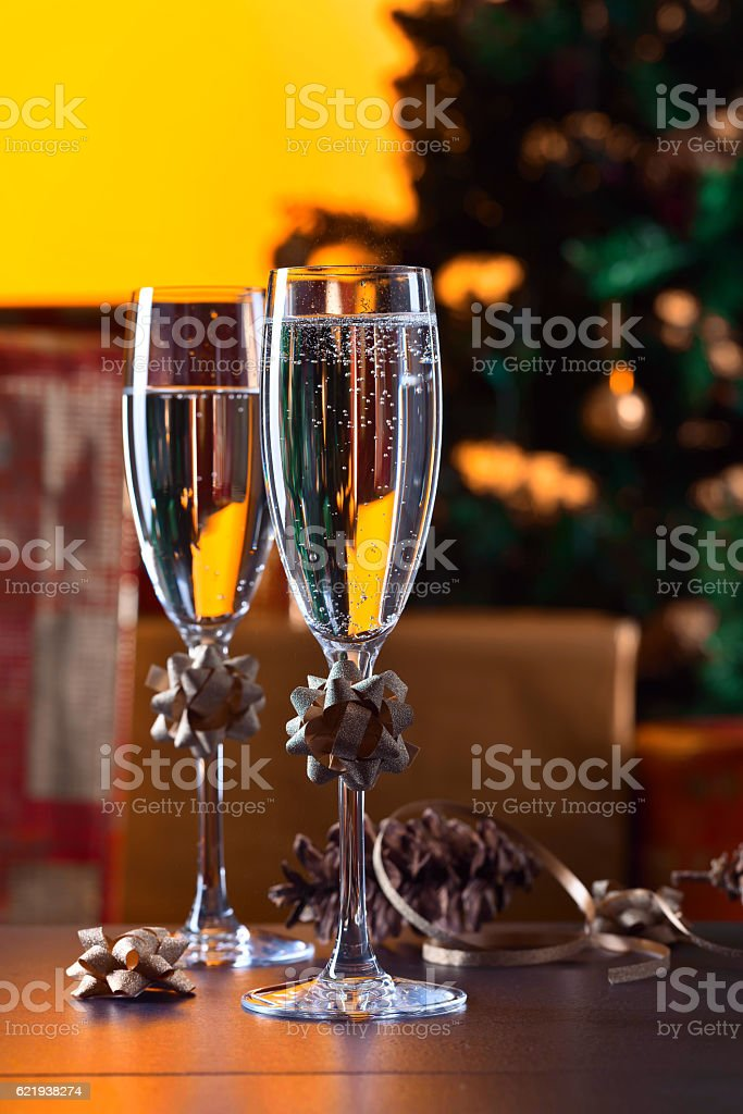 Two glasses with champagne and Christmas ornaments stock photo