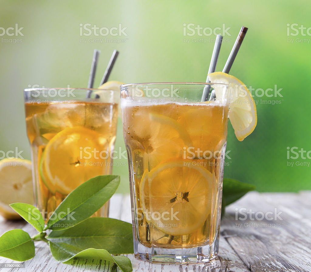 Two glasses with iced tea and lemons inside royalty-free stock photo