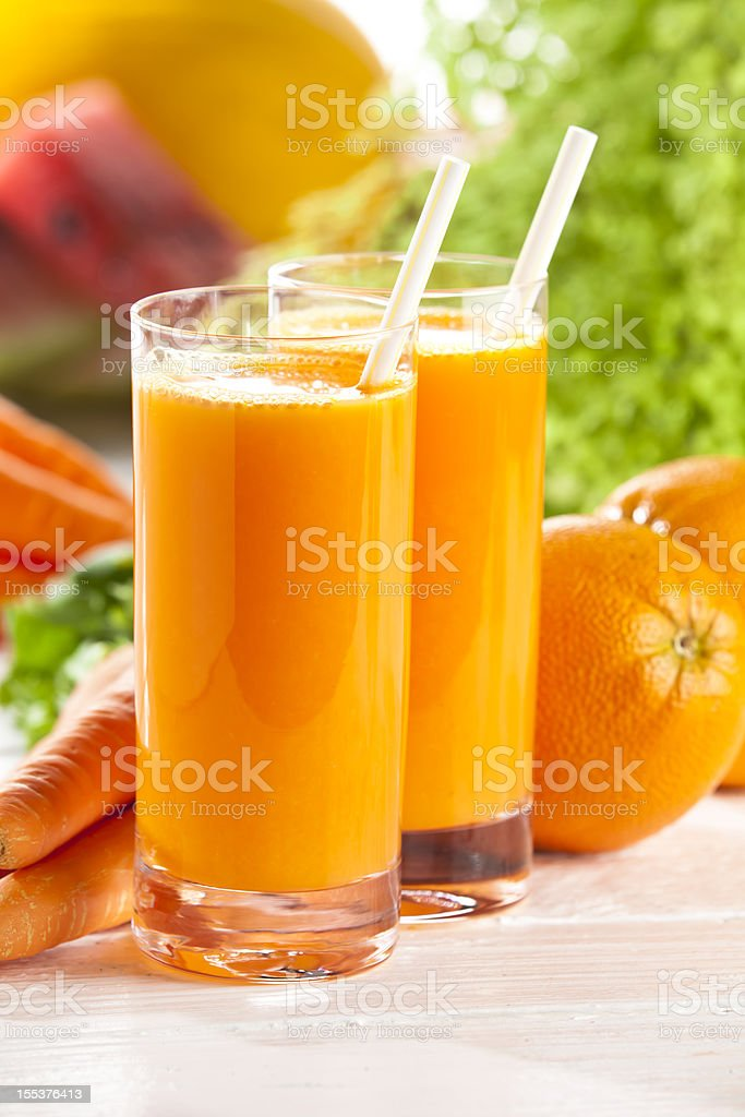 Two glasses with orange and carrot juice royalty-free stock photo