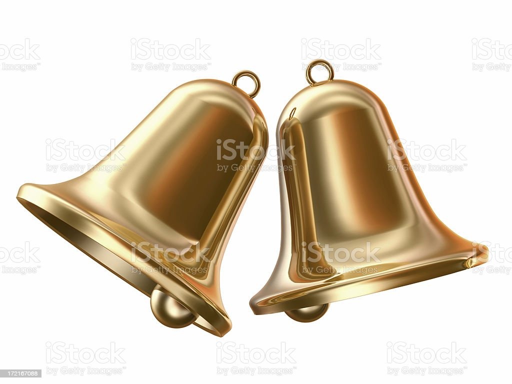 Two gold bells on a white background stock photo