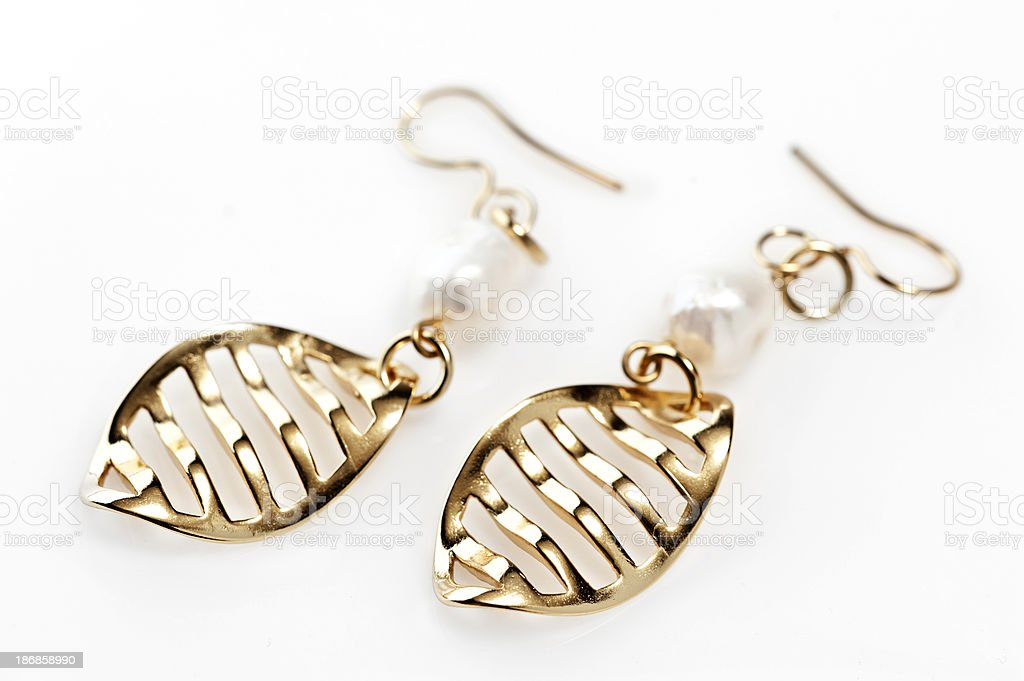 Two Gold Earings royalty-free stock photo