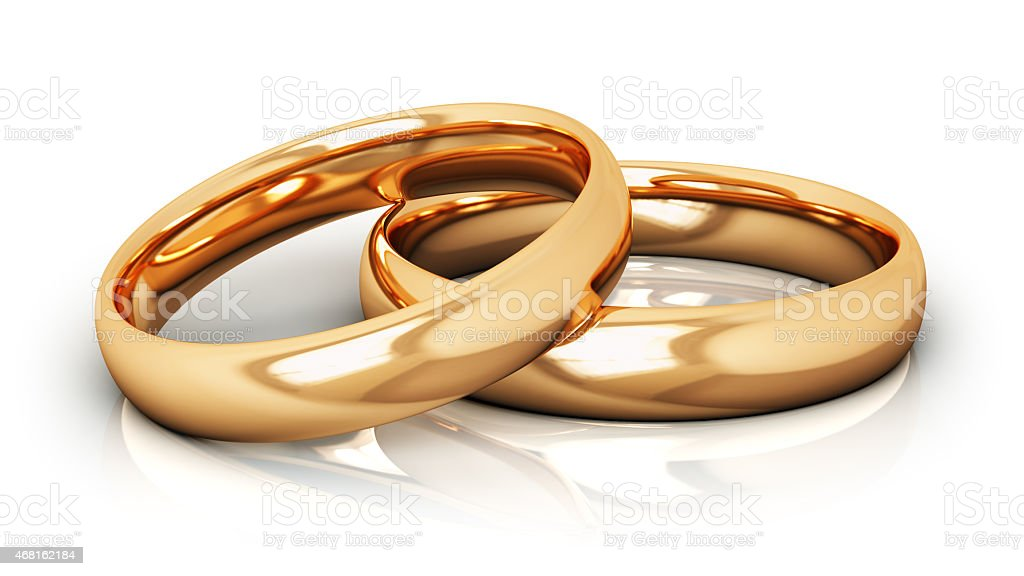 Two gold wedding bands on a white surface stock photo