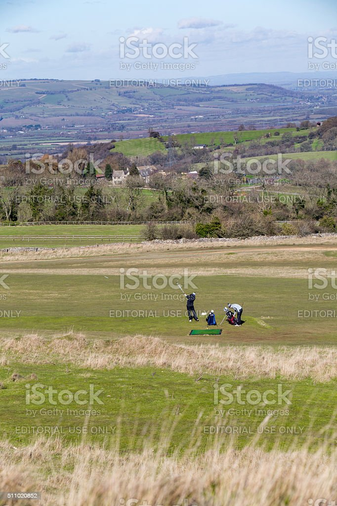 Two golfers playing a round of golf stock photo