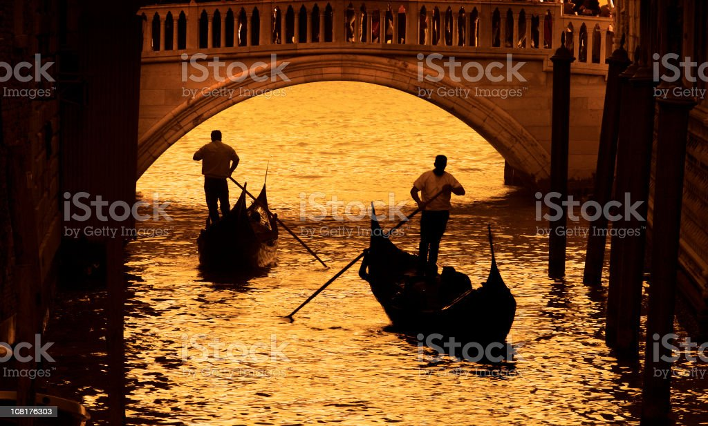 Two Gondoliers On Canals in Venice, Sepia Toned stock photo