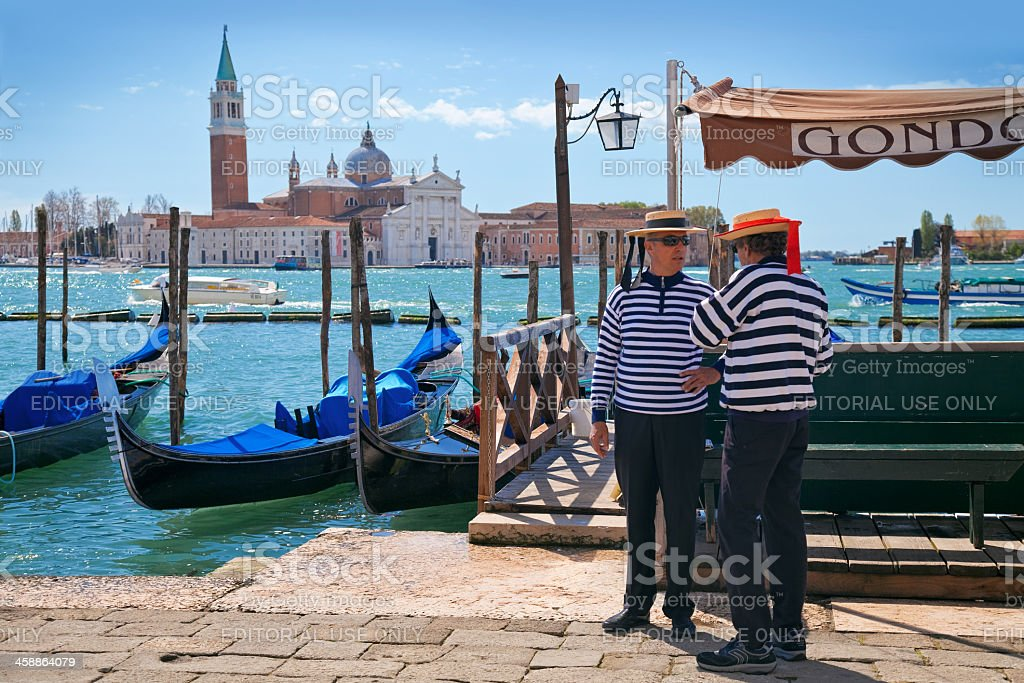 Two gondoliers on the Venetian quay. royalty-free stock photo