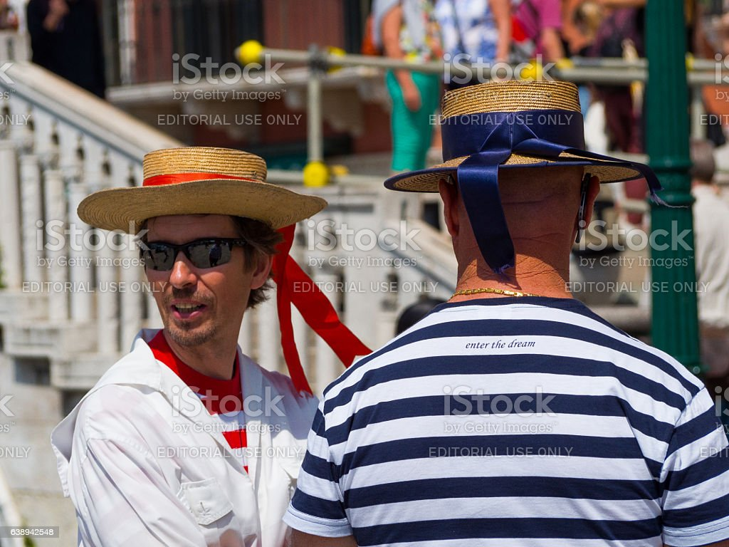 Two Gondoliers talking stock photo
