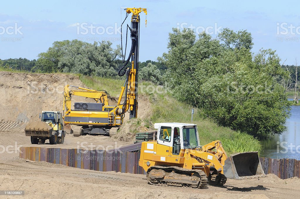 two Grader on a Construction Site of river dam stock photo