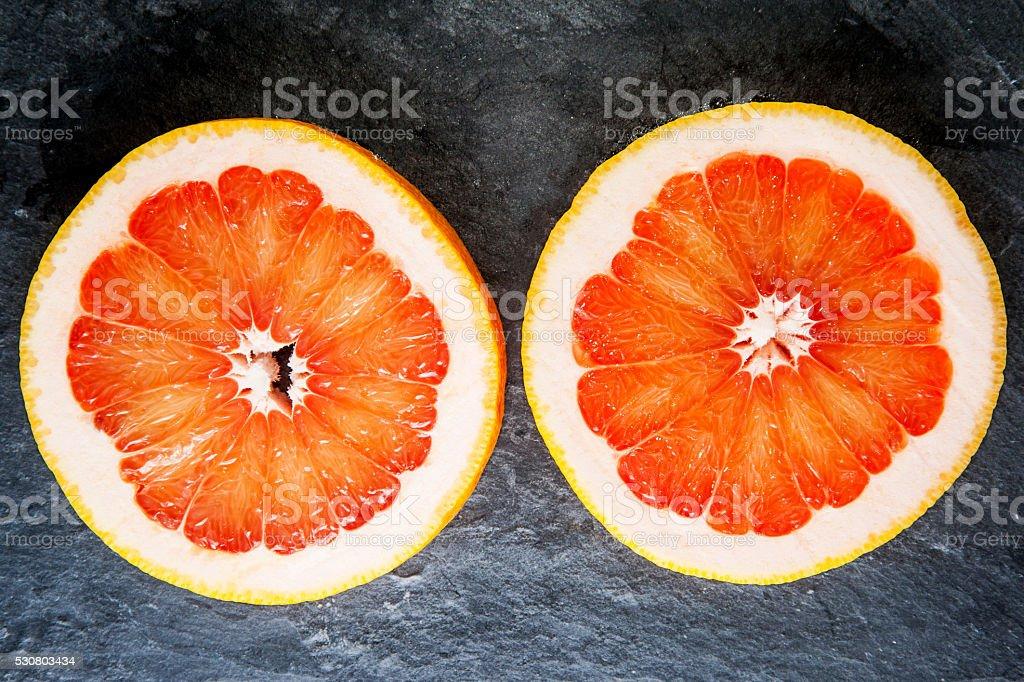 Two grapefruit slices stock photo