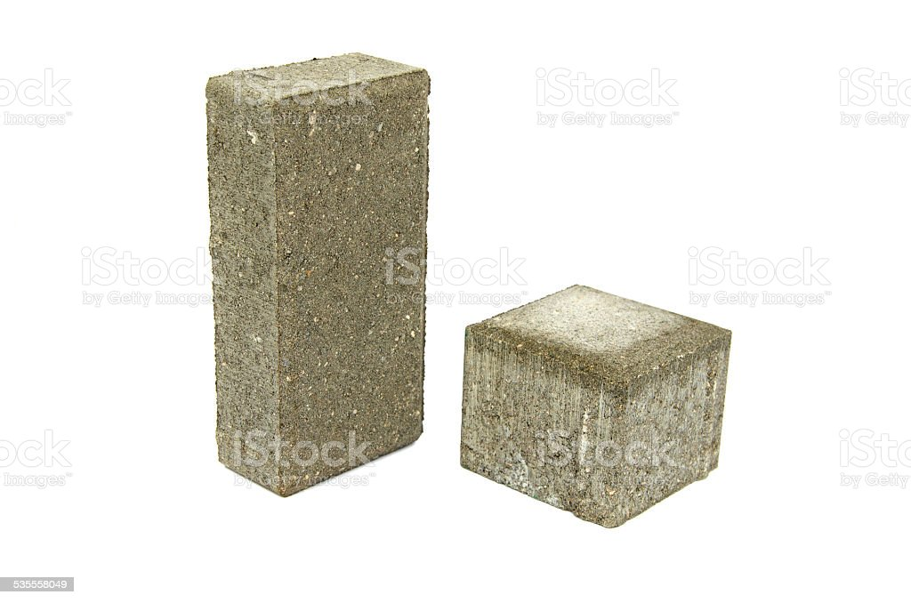 two  gray  street pavement concrete bricks paving stone isolated stock photo