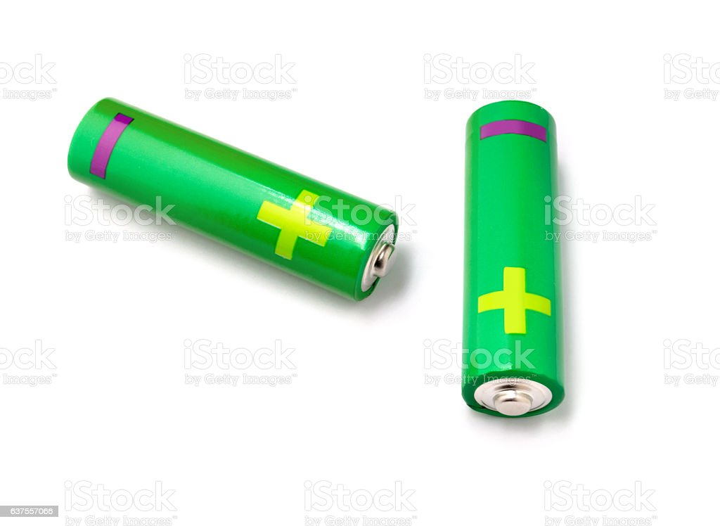 Two green AA batteries on a white background stock photo