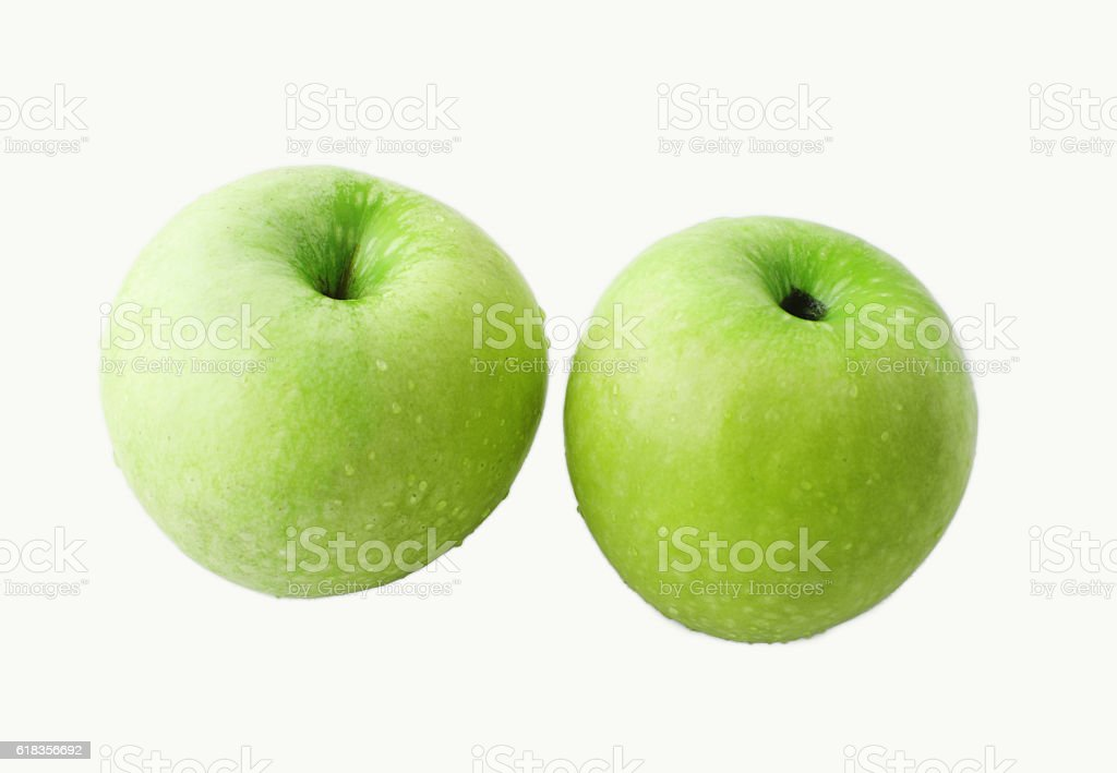 Two green apples on white background stock photo