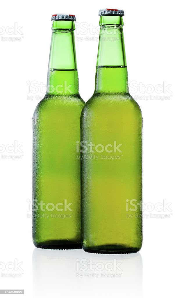 Two green bottles of beer with condensation isolated on white royalty-free stock photo