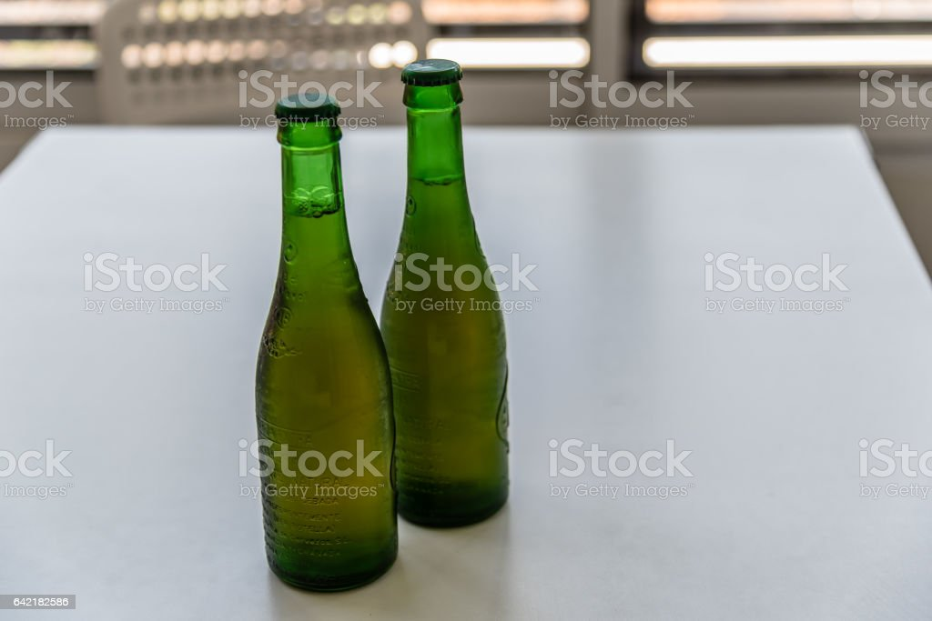 Two green bottles of  iced beer stock photo