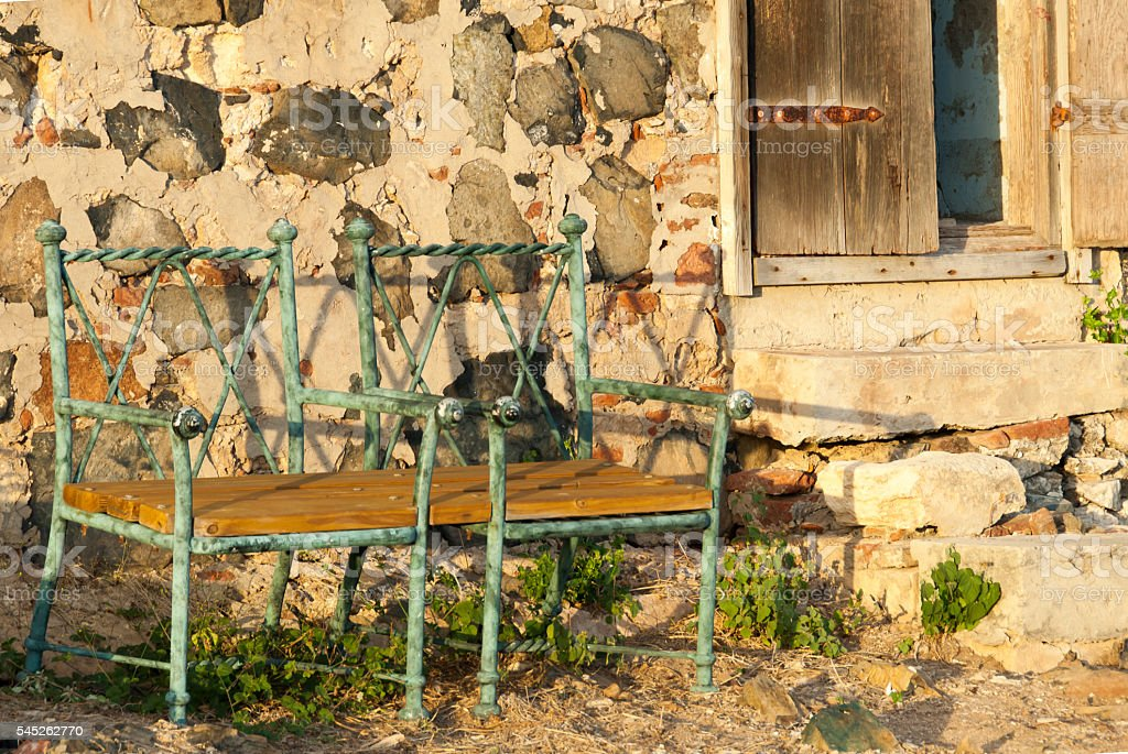 Two Green Chairs Outside an Abandoned Hut stock photo