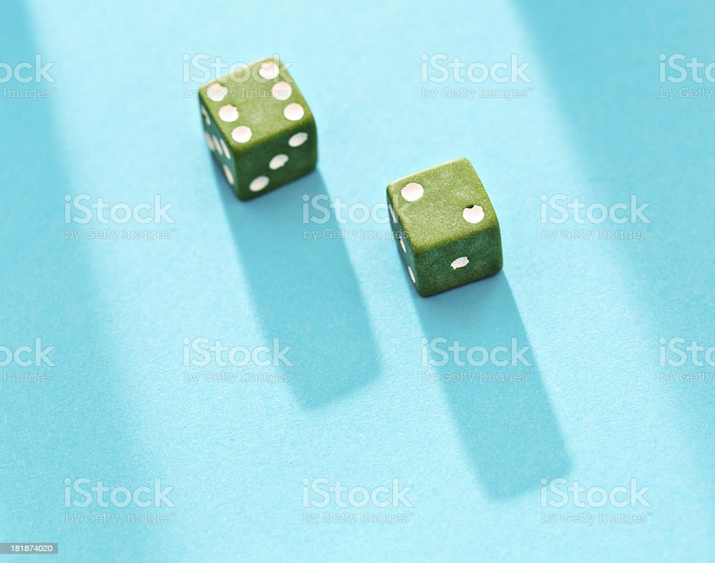 Two green dice showing 8 on bright blue royalty-free stock photo