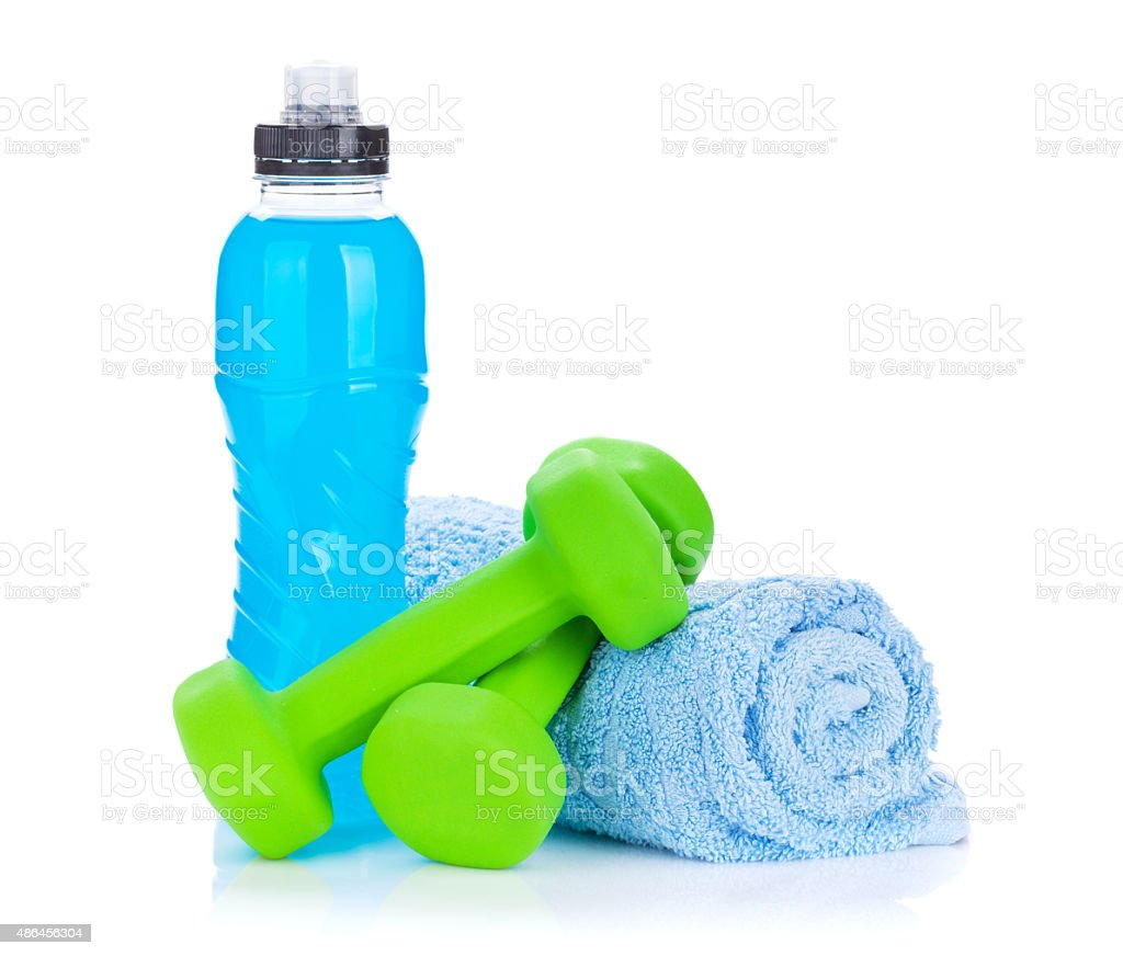 Two green dumbells, towel and water bottle stock photo