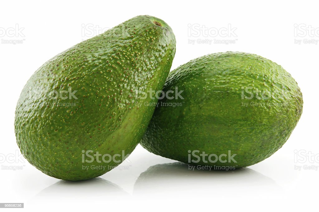 Two Green Ripe Avocado Isolated on White royalty-free stock photo