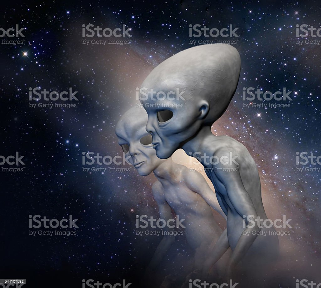 Two grey aliens on the background of the cosmos. stock photo