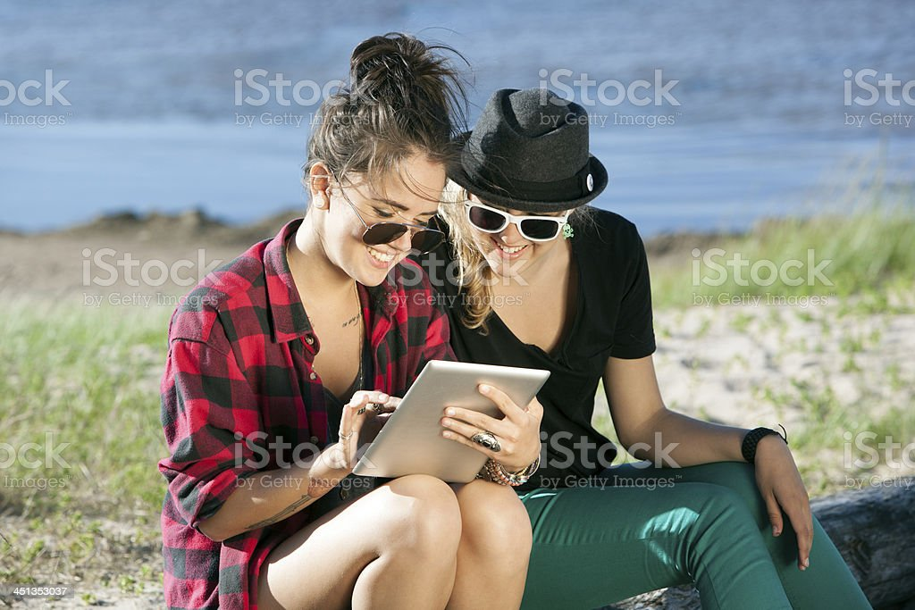 Two Grils using A Digital Tablet royalty-free stock photo
