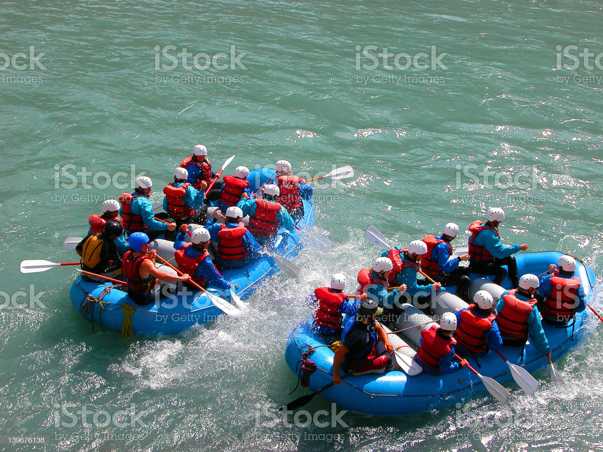 Two groups of people white water rafting royalty-free stock photo