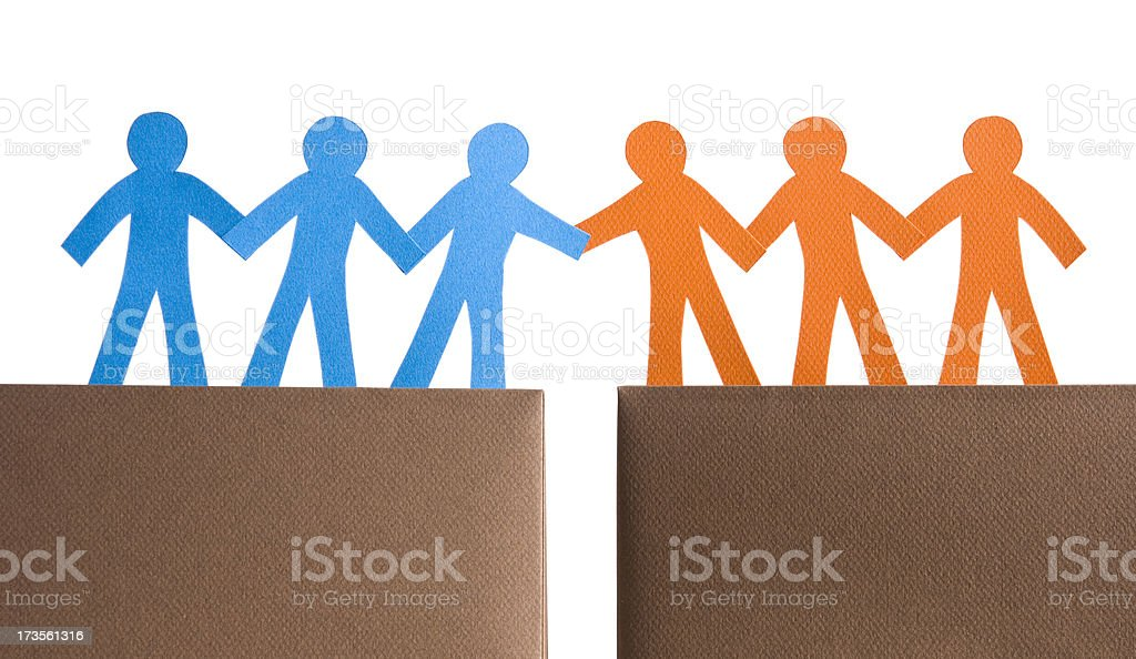 Two groups sealing a deal stock photo