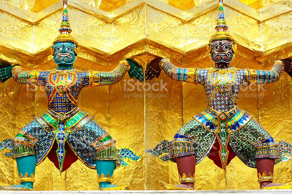 Two guardians of the Grand Palace in Bangkok, Thailand. stock photo