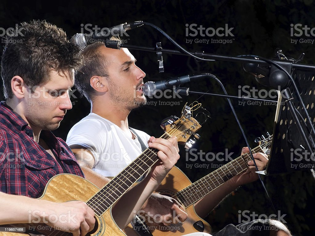 Two guitar players royalty-free stock photo