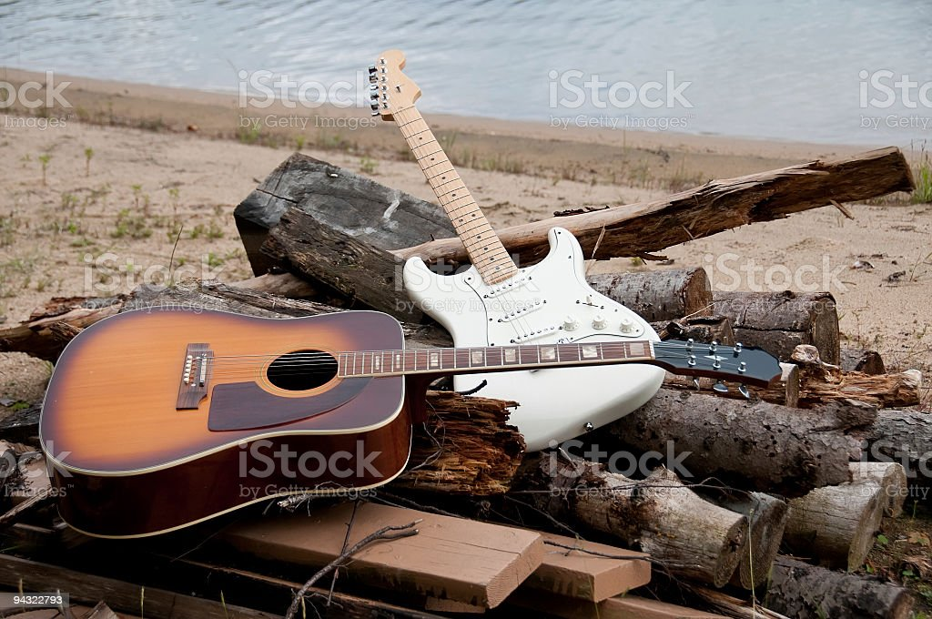 two guitars on the beach stock photo