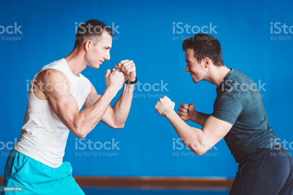Two Guys Boxing in The Gym stock photo