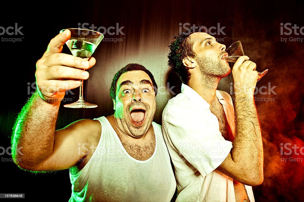two guys drink cocktail at the disco stock photo