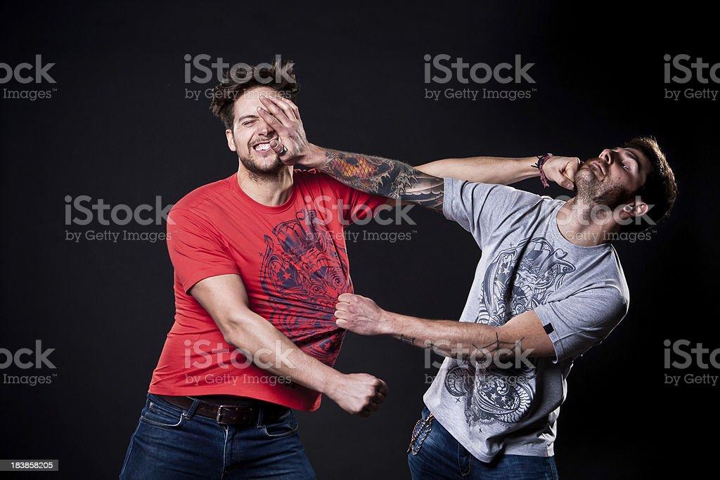 Two guys fighting. stock photo