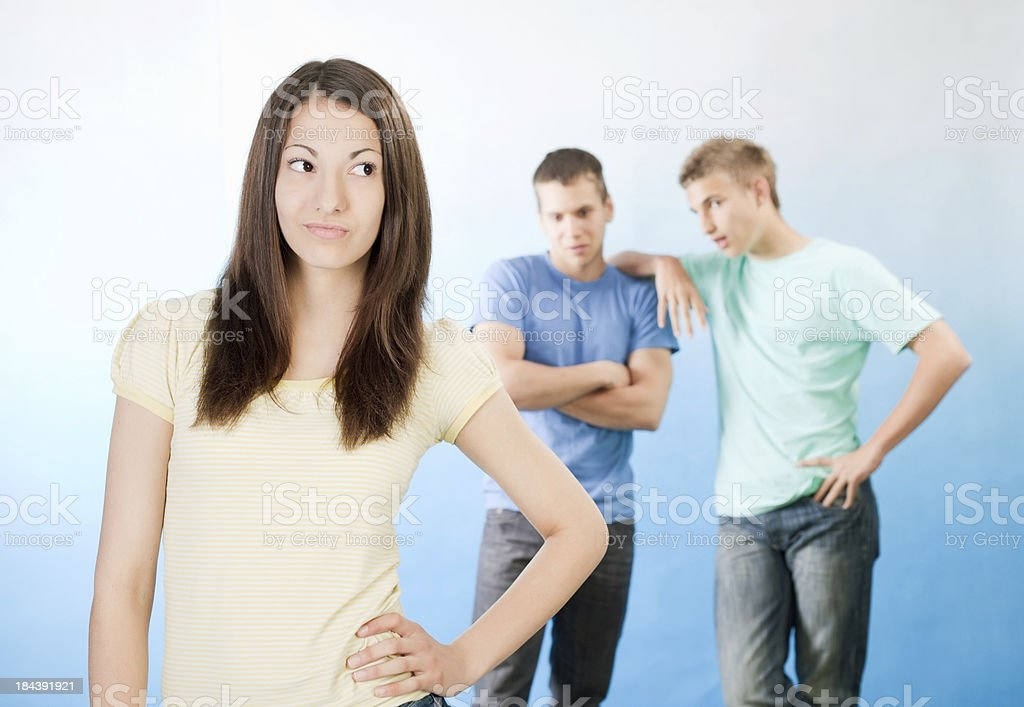 Two guys looking at popular school girl. royalty-free stock photo
