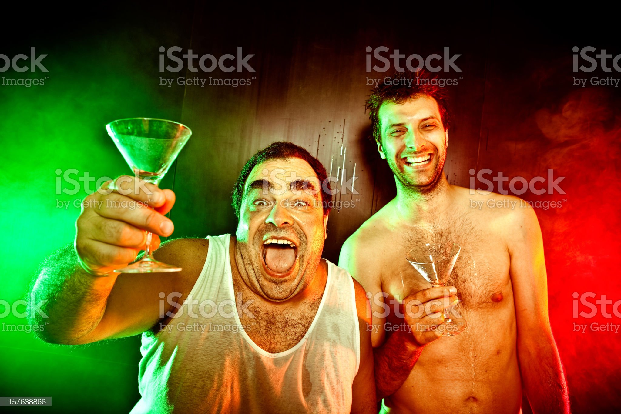 two guys with drinks cocktails yell at red green disco royalty-free stock photo